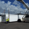 Mobile health units unloaded from ship